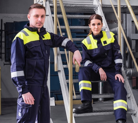man and woman wearing arc flash clothing for petrochemical sector