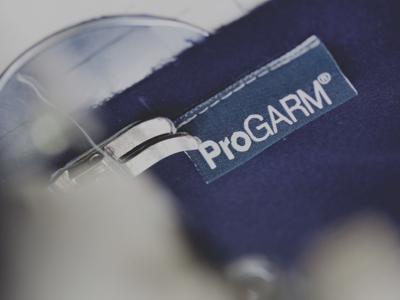 progarm logo close up on a blue garment