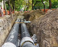 utility contractor pipes in ground